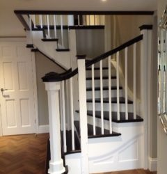 Ebonized treads, handrail and newel cappings