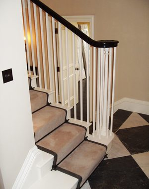 Cut String Staircase With Ebonized Handrail